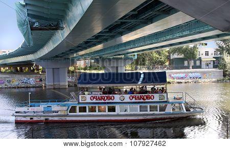 Pleasure Boat Sails Under The Bridge Across The River Sura, Penza