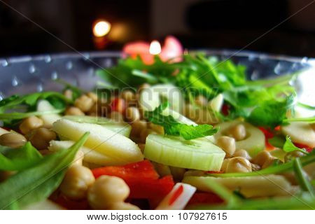 Fresh green salad on a glass bowl