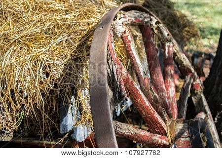 Antique wagon wheel with hay