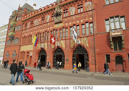 People walk in front of the Town Hall in Basel, Switzerland.
