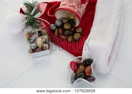 Candy Canes, Candies And Chocolate On Santa Hat Isolated