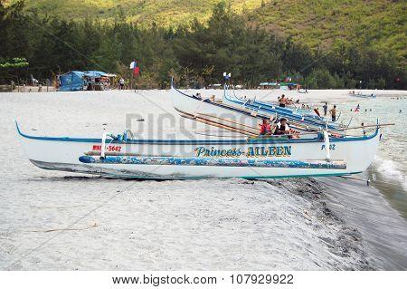 Fishing boats in Anawangin Cove, Zambales, Philippines
