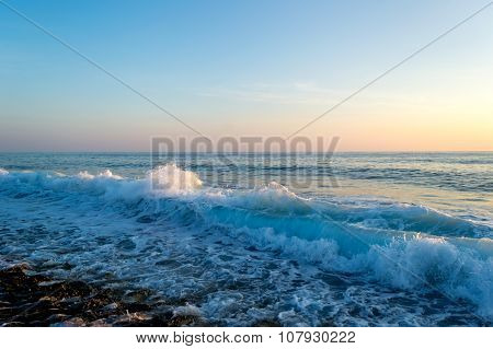 Waves Breaking On A Stony Beach, Forming Sprays