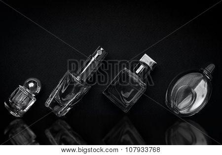 Different Perfume Bottles On The Dark Background