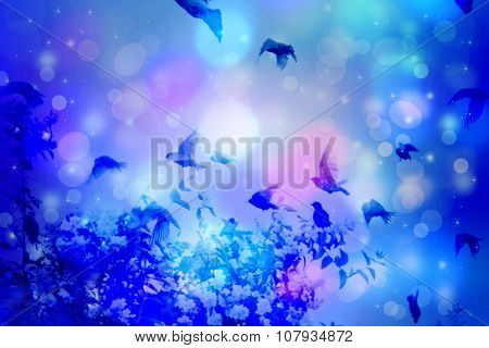 Dreamy Winter Scene With Starling Birds Flying Against Blue Sky With Bokeh Light