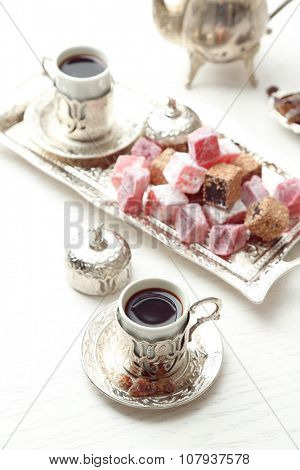 Antique tea-set with Turkish delight on table close-up
