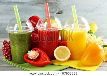 Fresh juice mix fruit, healthy drinks on wooden table background