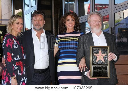 LOS ANGELES - NOV 05:  Kristen Wiig, Russell Crowe, Giannina Facio, Ridley Scott at the Ridley Scott Hollywood Walk of Fame Star Ceremony at the Hollywood Blvd on November 05, 2015 in Los Angeles, CA