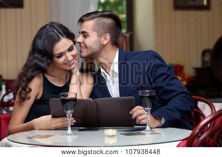 young couple flirting at the restaurant