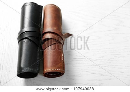 Leather cases on light wooden
