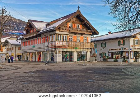GARMISCH-PARTENKIRCHEN GERMANY - JANUARY 06 2015: Charming small Bavarian town with beautifully decorated houses on a sunny winter day. Garmisch-Partenkirchen Bavarian Alps Germany