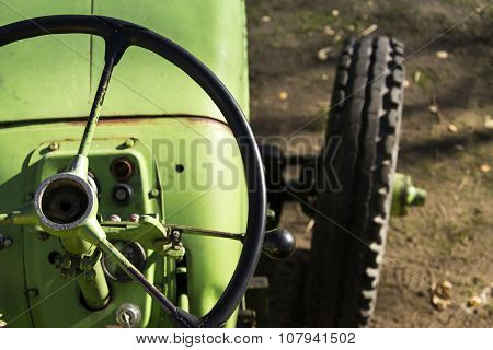 Old Green Vintage Tractor Stands On Farm Yard