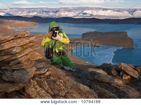 The girl the photographer on mountain about Baikal