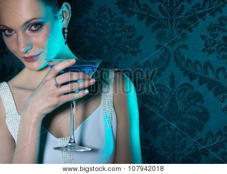 Noble beautiful woman in turquoise light on damask wallpaper background