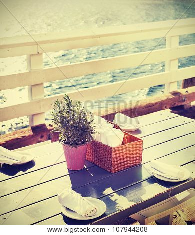 Vintage Toned Table Setting On Pier At Sunset, California, Usa.