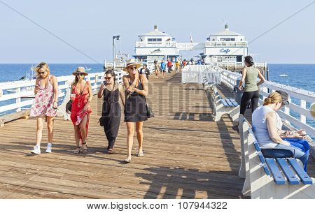 People Walking On The Malibu Pier.
