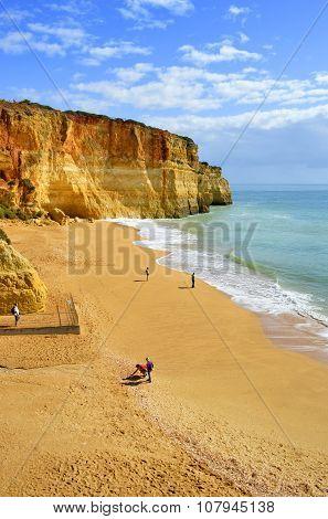 Benagil, Algarve, Portugal - October 27, 2015 tourists on Benagil Beach on the Algarve coast