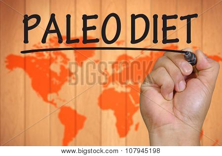 Hand Writing Paleo Diet Over Blur World Background