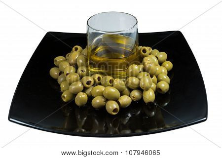 Green Olives And Olive Oil Isolated On White