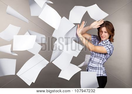 Young Business Woman With Flying Documents