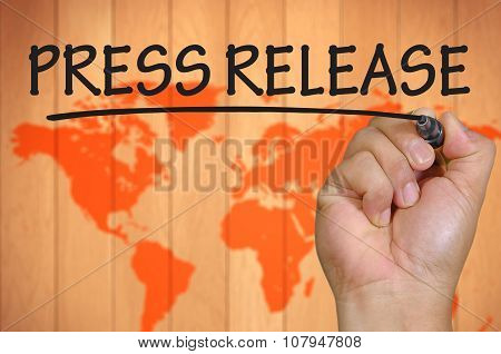 Hand Writing Press Release Over Blur World Background