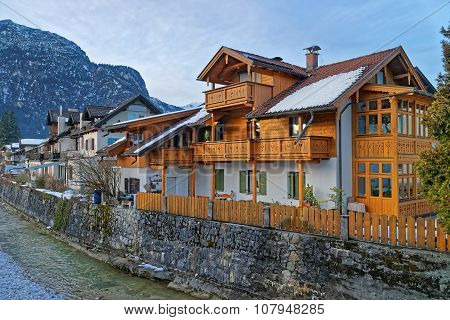 Typical wooden chalet in Garmisch-Partenkirchen. It is an idyllic mountain resort town in the valleys of the Bavarian Alps beneath the towering Zugspitze peak