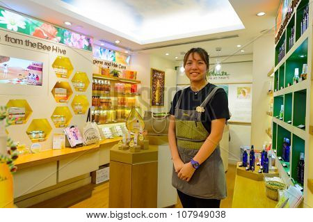 HONG KONG - NOVEMBER 02, 2015: seller of the cosmetics store in New Town Plaza. New Town Plaza is a shopping mall in the town centre of Sha Tin in Hong Kong. Developed by Sun Hung Kai Properties