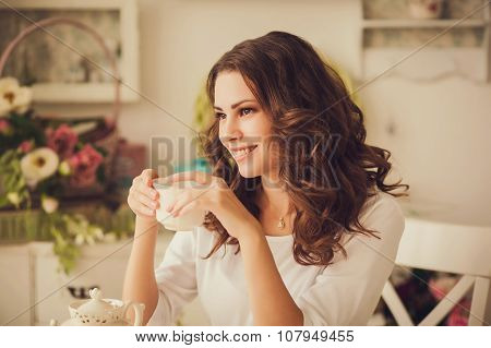 Woman Sipping Tea