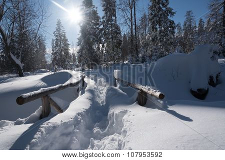 Mountain Trail Covered With Snow And Large Snowdrifts