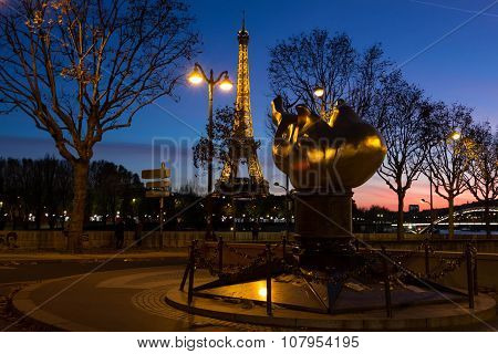The Eiffel Tower And Monument Flame Of Liberty, Paris, France.
