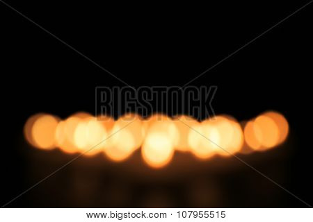 Unfocused alight candles, close up