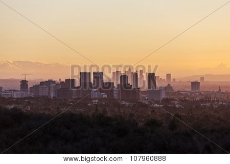 Warm dawn light on Century City and Beverly Hills with downtown Los Angeles in the background.