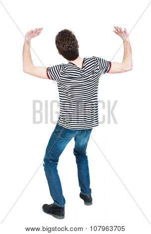 back view. man  protects hands from what is falling from above. Man holding a heavy load Rear view people collection.  backside view of person.  Isolated over white background.