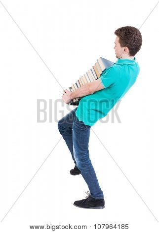Back view of going  handsome man carries a stack of books. walking young guy . Rear view people collection.  backside view of person.  Isolated over white background. Man corrects foot stack of books