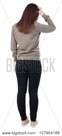 back view of standing young beautiful  woman.  Girl scratching head. Rear view people collection.  backside view of person.  Isolated over white background. Insecure girl froze in thought