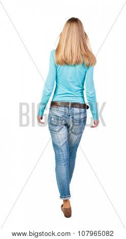 side view of walking  woman in jeans. beautiful girl in motion.  backside view of person.  Rear view people collection. Isolated over white background. The blonde in a blue sweater goes forward.