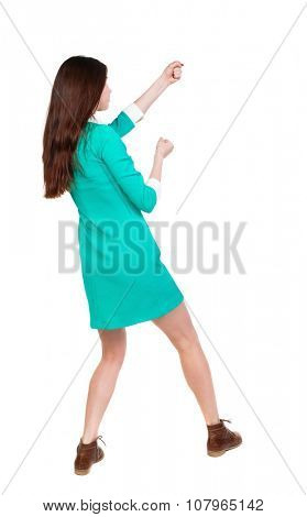 back view of standing woman pulling a rope from the top or cling to something.  Rear view people collection.  backside view of person.  Isolated over white background.