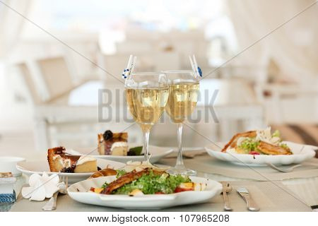Tasty salad with served wine