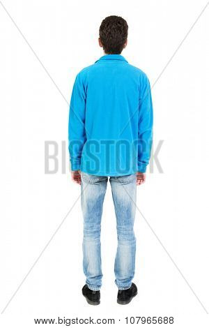 Back view of man in jeans. Standing young guy. Rear view people collection.  backside view of person.  Isolated over white background.  The guy in the blue sweater looking straight ahead ..