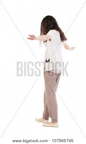 Back view woman is balancing on a tightrope.   Standing young girl in parka. Rear view people collection.  backside view of person.  Isolated over white background.
