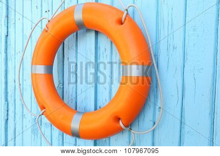 A life buoy on blue wooden background