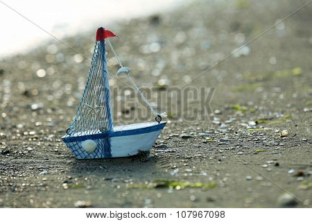 A little yacht on the seashore