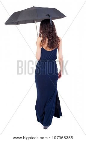 young woman in dress walking under an umbrella.. Rear view people collection.  backside view of person.  Isolated over white background. Girl in evening dress is holding a hand bottom of the dress.