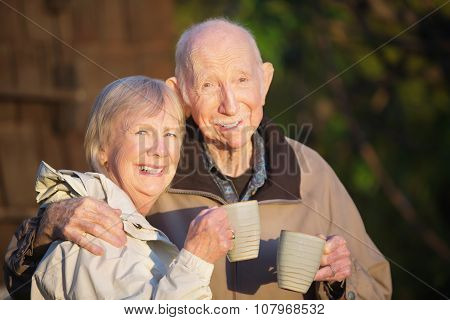 Older Couple With Coffee Outdoors