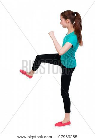 skinny woman funny fights waving his arms and legs. Rear view people collection.  backside view of person.  Isolated over white background.