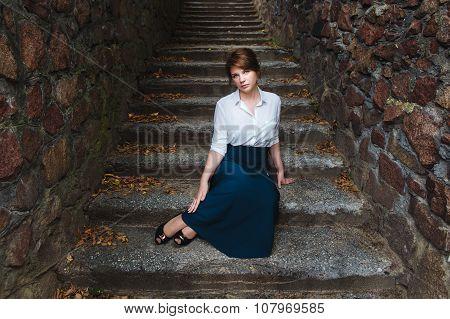 Beautiful Dark-haired Girl In A Long Dress