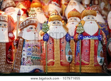 Santa Claus Statues As A Background