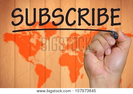 Hand Writing Subscribe Over Blur World Background