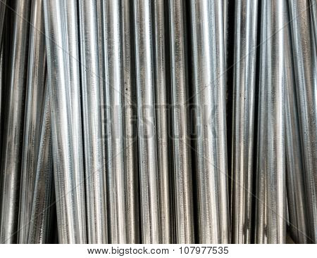 Metal poles for sale in a hardware shop
