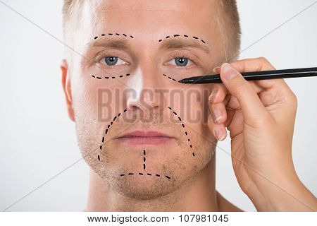 Man's Face With Correction Line Drawn By Person's Hand